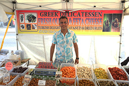 Greek stall selling olives stuffed with cayenne chillies